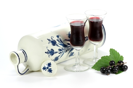 delftware: Dutch gin flavored with black currants traditionally served in tulip-shaped glasses Stock Photo