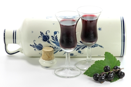 traditionally dutch: Dutch gin flavored with black currants traditionally served in tulip-shaped glasses Stock Photo