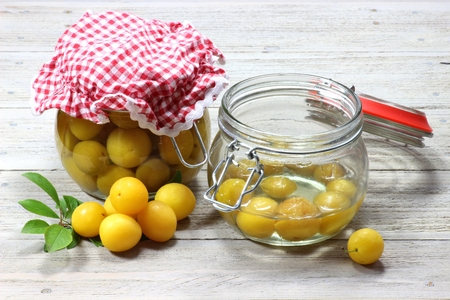 canned: home canned mirabelle plums Stock Photo