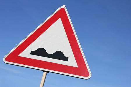 bumpy: German road sign - bumpy road