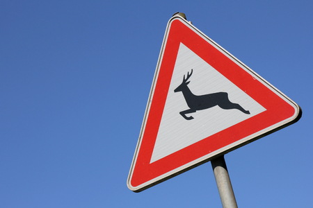 staying in shape: German road sign - wild animals