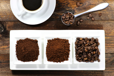 robusta: assortment of different coffee products on wooden background