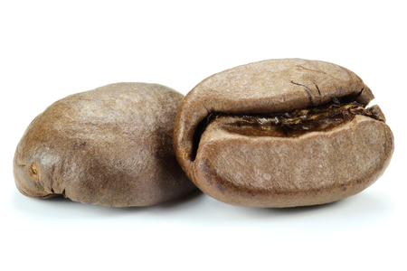 fairtrade: roasted coffee beans isolated on white background