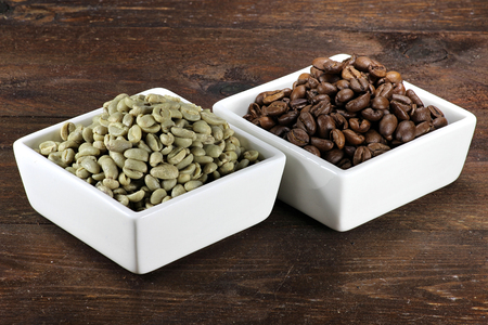 unroasted: roasted and unroasted coffee beans
