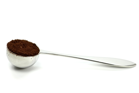 fairtrade: coffee scoop isolated on white background