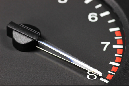 dynamically: tachometer in red zone Stock Photo