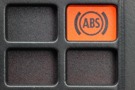 damage control: ABS warning light in car dashboard