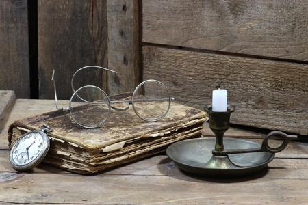 old metal: antique book with accessories on wooden background