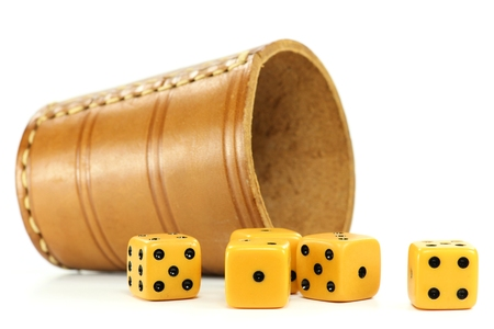 pip: dice cup with five dices on white background Stock Photo