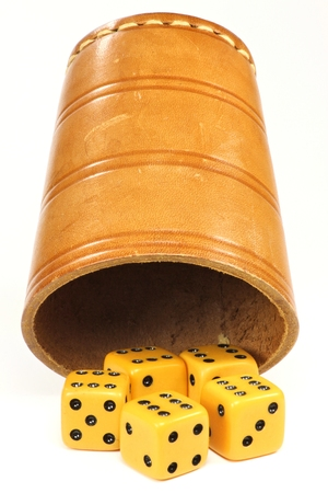 jackboots: dice cup with five dices on white background Stock Photo