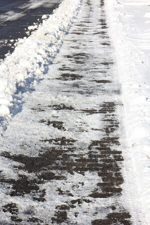 skidding: frosted sidewalk in winter