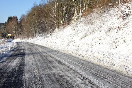 skidding: frosted road in winter