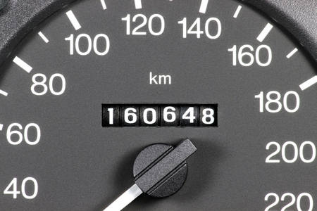 mileage: odometer of used car showing mileage of 160648