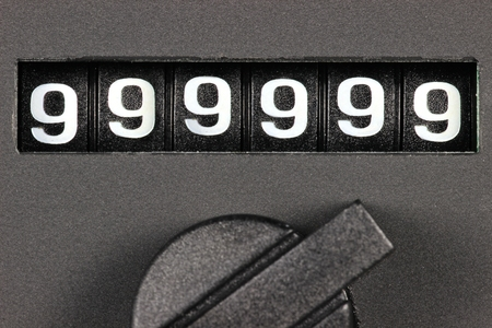 odometer of used car showing mileage of 999999