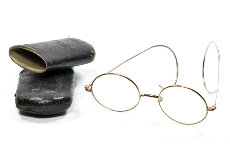 nearsighted: old glasses with case isolated on white background
