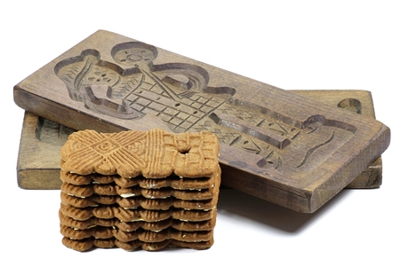 speculaas: wooden molds with speculaas on white background
