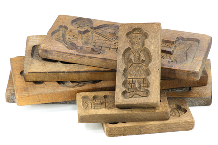speculaas: wooden molds speculaas on white background