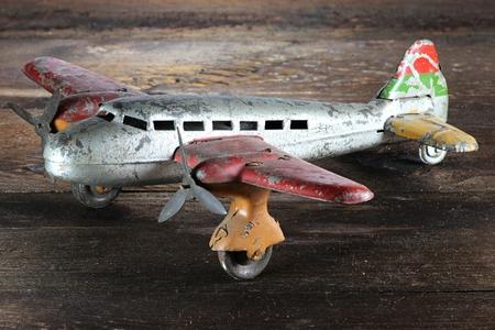 antique tin toy plane on wooden background