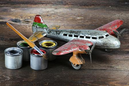 restoration: antique tin toy plane under restoration