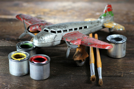 antique tin toy plane under restoration