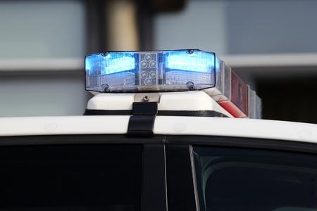 emergency vehicle: police car with blue emergency vehicle lighting Stock Photo