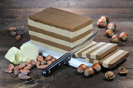 layer cake: layer cake nougat on wooden background Stock Photo
