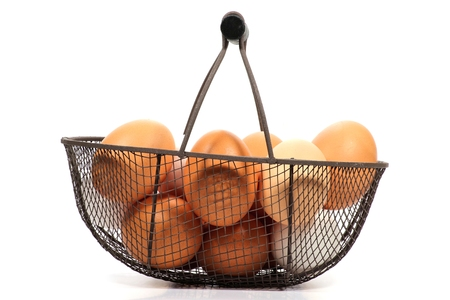 basketful: eggs in a basket isolated on white background