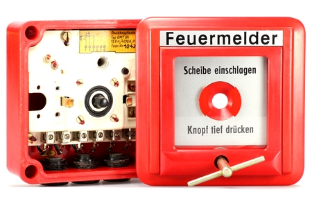 pushbutton: German push-button fire alarm isolated on white background