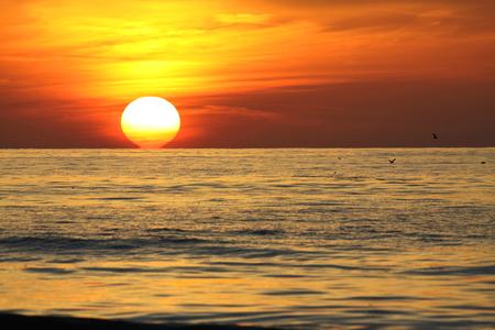 mood moody: sun sinking into the sea