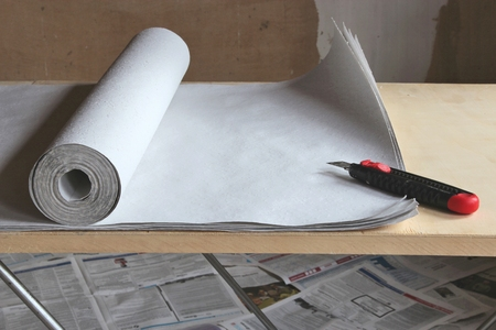 boxcutter: woodchip wallpaper on pasting table Stock Photo