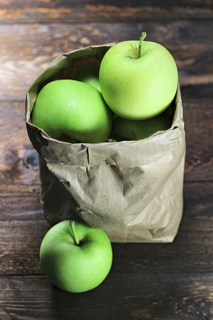 mellowness: apples variety Delcorf on wooden background