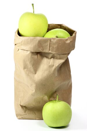 apple paper bag: apples variety Delcorf isolated on white background