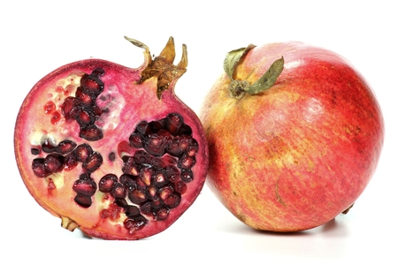 mellowness: pomegranate isolated on white background Stock Photo