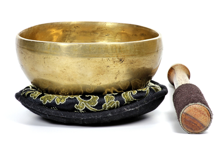 sound healing: small singing bowl isolated on white background Stock Photo
