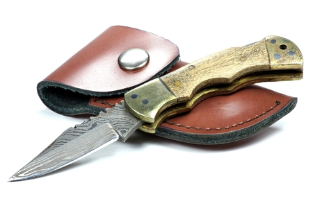 pocket knife: handmade damascus pocket knife isolated on white background