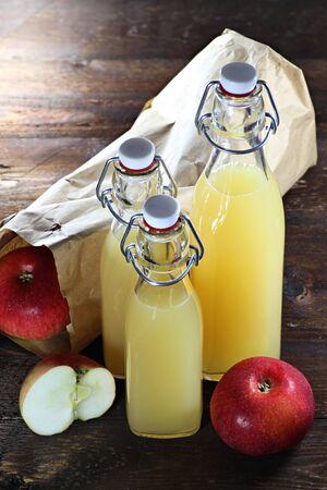 windfalls: homemade apple juice on wooden background