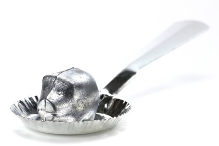 to foresee: lead piece and spoon for molybdomancy