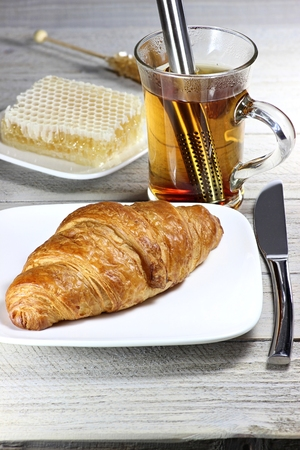 honey comb: tasty breakfast with croissant and comb honey Stock Photo