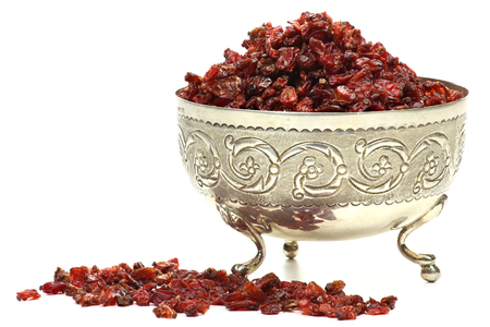 barberries: Dried barberries in a silver bowl isolated on white background