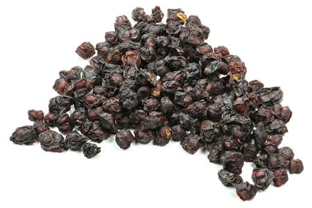 dried schisandra berries isolated on white background
