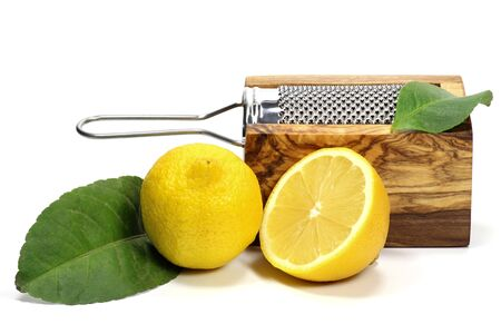 mellowness: organic lemons with grater isolated on white background