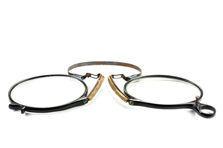 nearsighted: antique pince-nez isolated on white background
