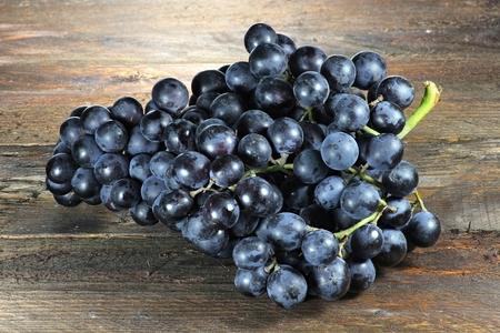 biological vineyard: grapes variety Muscat Bleu on wooden background