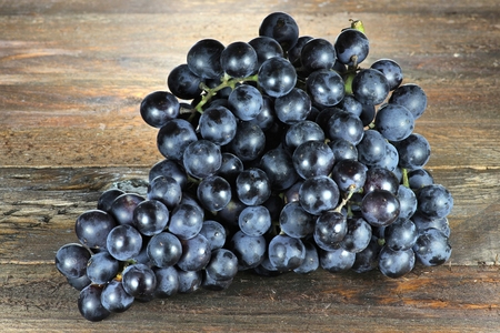 mellowness: grapes variety Muscat Bleu on wooden background