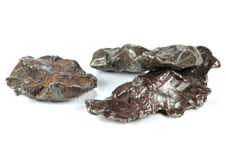 meteorites: fragment of the Sikhote-Alin meteorite isolated on white background