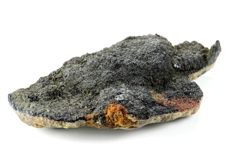 mineralogy: uraninite found in Oberschlema Ore Mountains  Germany isolated on white background