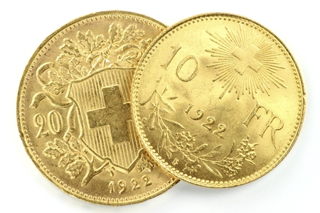 helvetia: Swiss Vreneli gold coins on wooden background