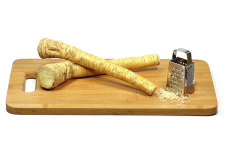 ripeness: horseradish with grater isolated on white background