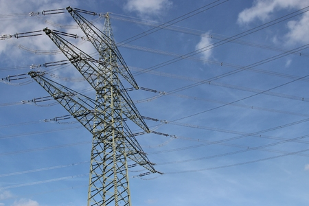 electricity providers: electricity pylon against blue sky