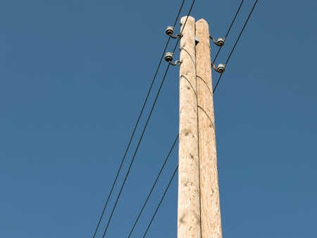 providers: wooden power pole against blue sky